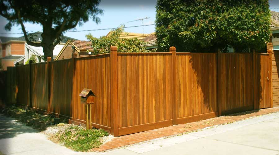 Modern shiplap timber fence coated with a natural protective coating and is also suitable for painting