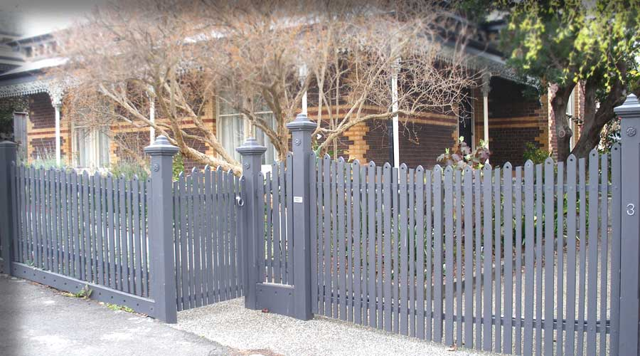 Fence includes Staggered Configuration, Special Capitals, post tops and pickets and Automated Swing Gates