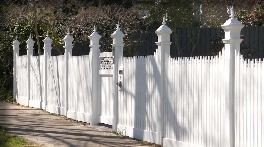 Fence includes a Rise and Fall Configuration with Pickets, Angelina Capitals, Scotia and custom made Gate